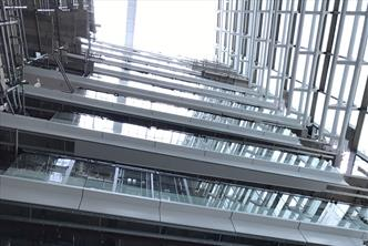 Atrium balustrade c/w st/st top rail, glass infill and aluminium flashings
