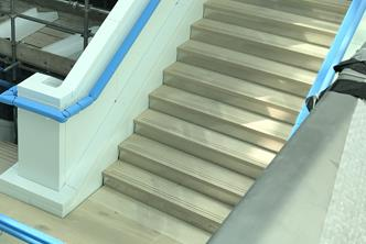 10 flight Feature staircase, with aluminium cladding, glass infills and timber balustrade, treads and landings